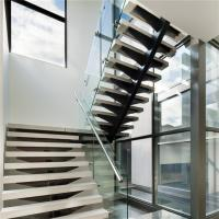 Mono stringer staircase design with wood tread glass railing