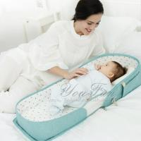 China Portable Bed Bag Travel Crib Carry-on Nest Bed Diaper Bag Bed on sale