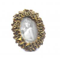 Buy cheap Environmentally Antique Oval Gold Picture Frames With Petal Leaf Waved Twist from wholesalers