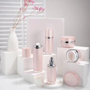 Quality China manufacturer plastic cosmetic pink bottle sets cream jar 50ml 100ml lotion bottle jar set for sale