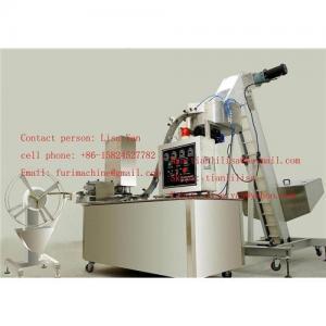 Cap wad inserting machine/cap lining machine